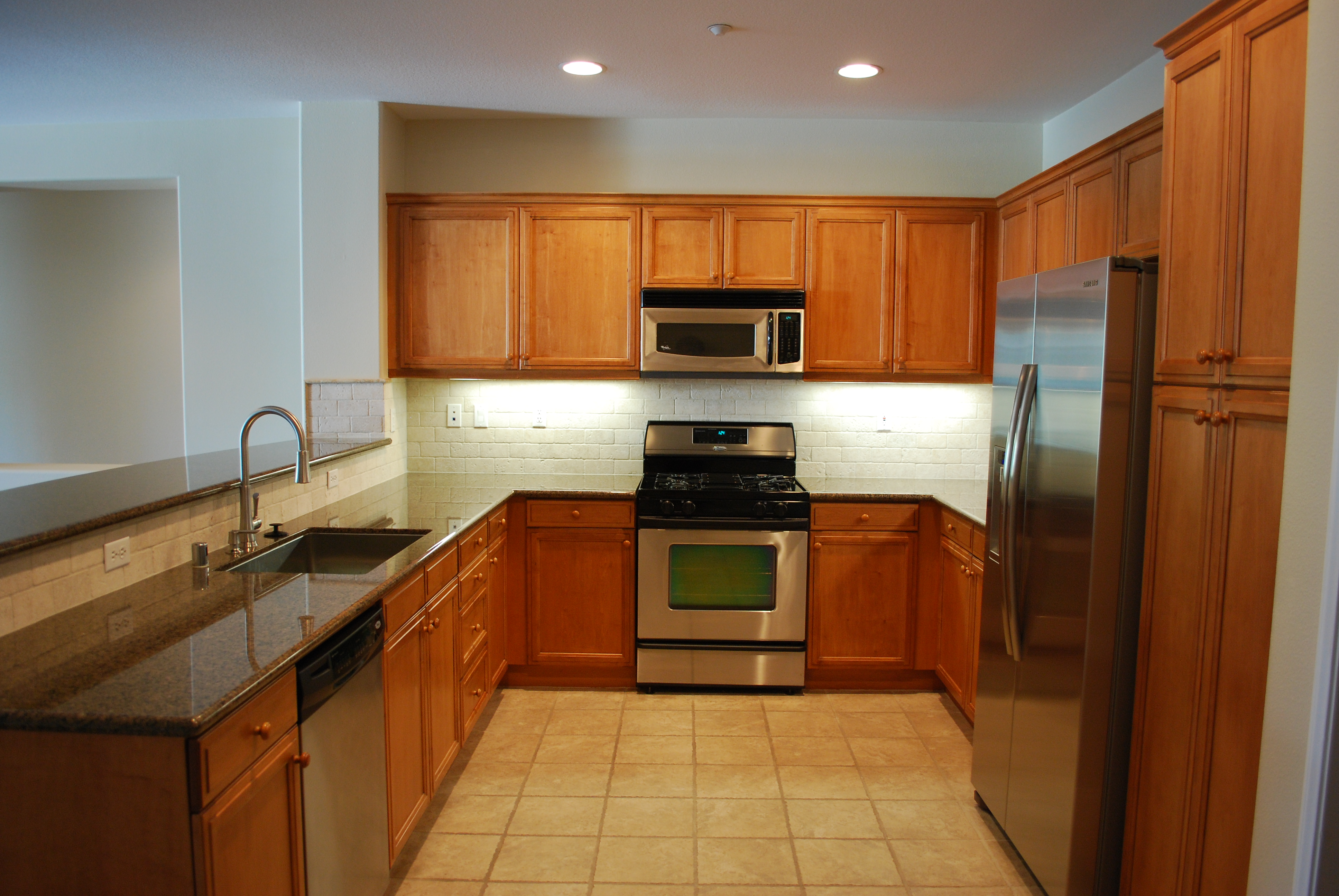 This Project Was Counter Top Upgrade From The Original White Tile That Was  Around 5 Years Old To A Full Custom Tropical Brown Granite Slab Counter Top.